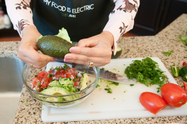ALL ABOUT THAT GUAC: Chef Ahki adds avocado to a bowl of diced Roma tomatoes, red onion, cilantro and jalapeno.